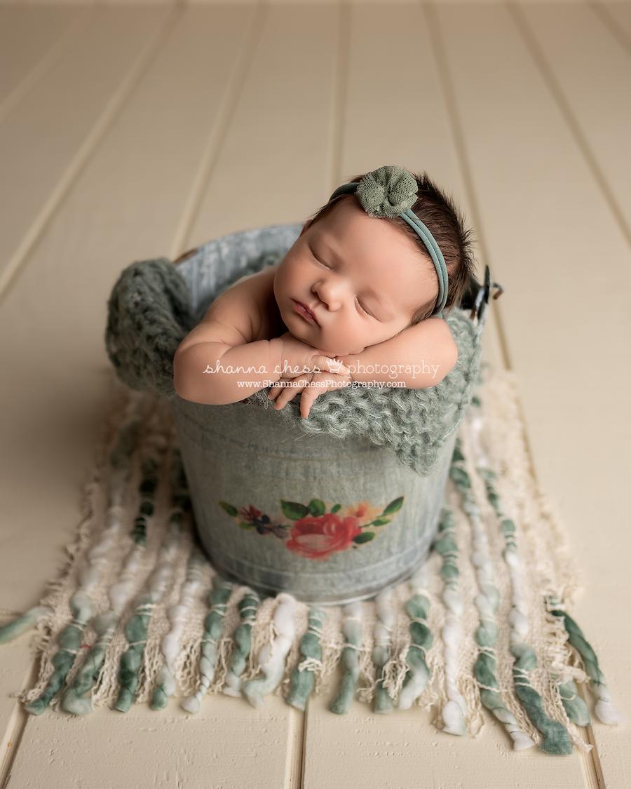 newborn girl asleep in bucket, Eugene OR newborn photography