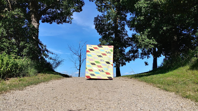 Rockslide quilt made with First Frost and Superior Solids from Benartex