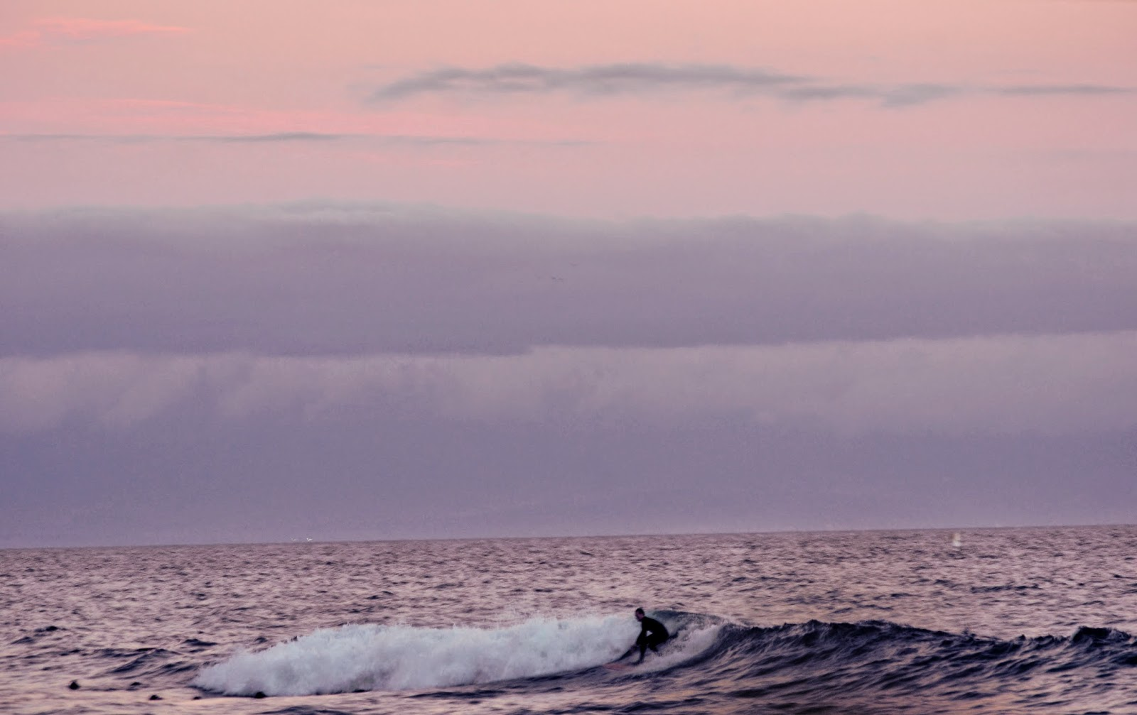 Surfer at Dusk in Cape Town