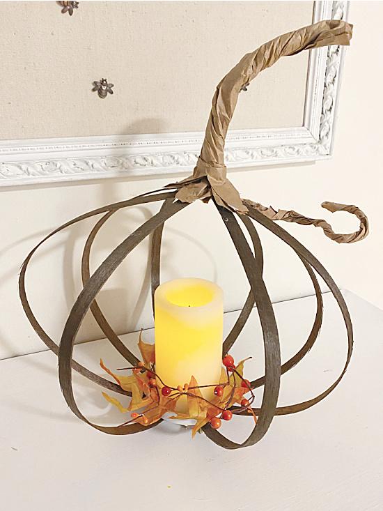 pumpkin lantern with fall foliage