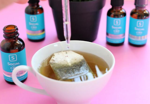 CBD oil on a table with tea
