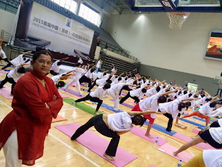 Mrs. Radha President of PICFA at the - 1st International Day of Yoga -observed at Kunming University-21/06/2015
