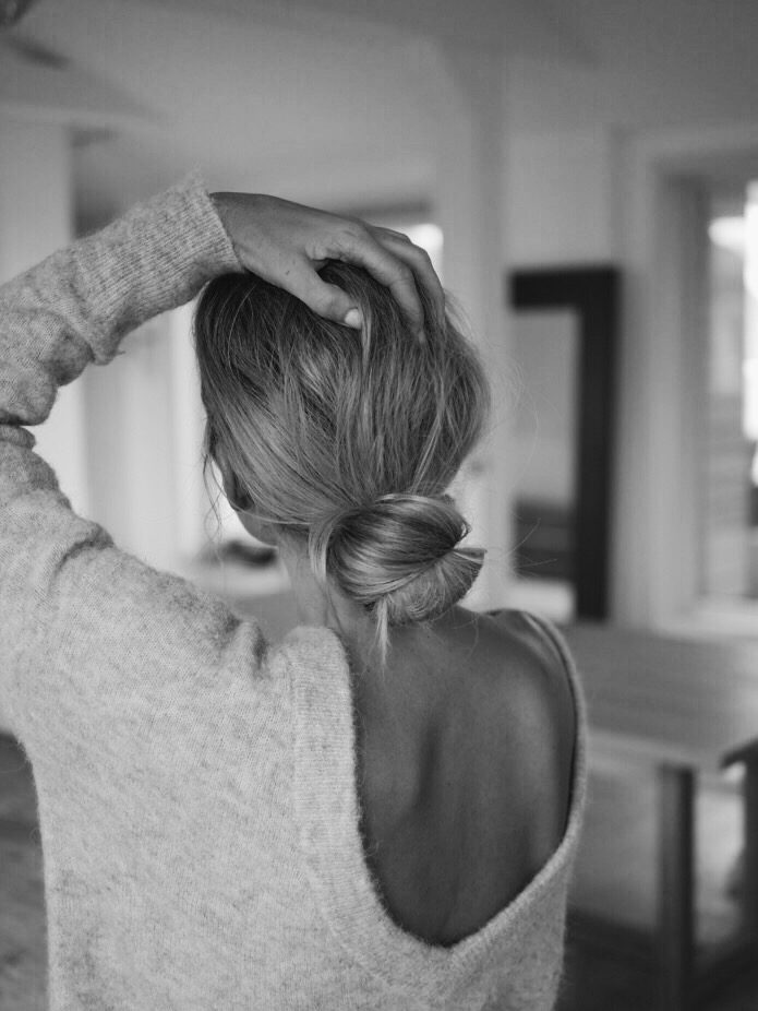 Low Bun Hair Inspiration Paired With a V-Back Sweater