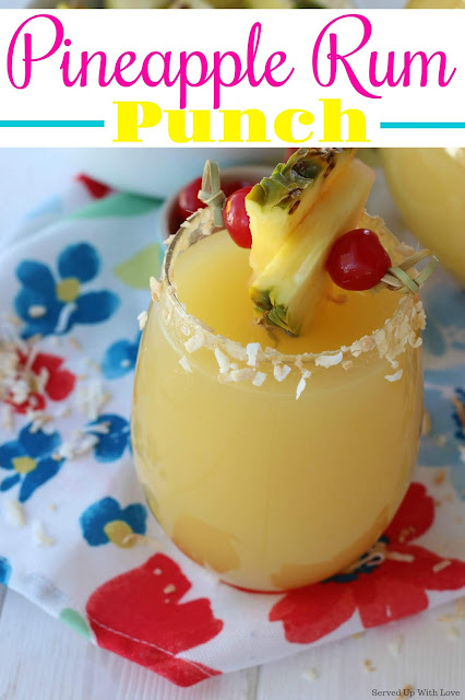 Pineapple rum punch in a cocktail glass with toasted coconut on the rim