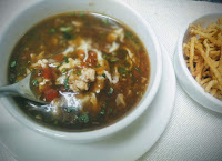 Chicken manchow soup serving with fried noodles
