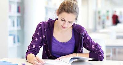 College student reading financial information