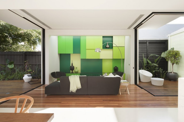 Small living room with green wall