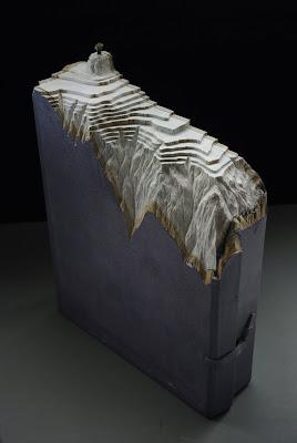 Arte con libros y enciclopedias completas.