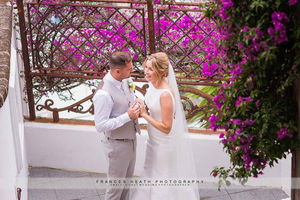 Bride and groom with Positano flowers