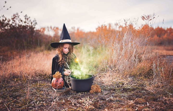 girl making witches potions in a field