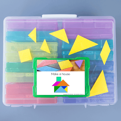 Photo of task card and tangrams on top of large bin of task card containers.
