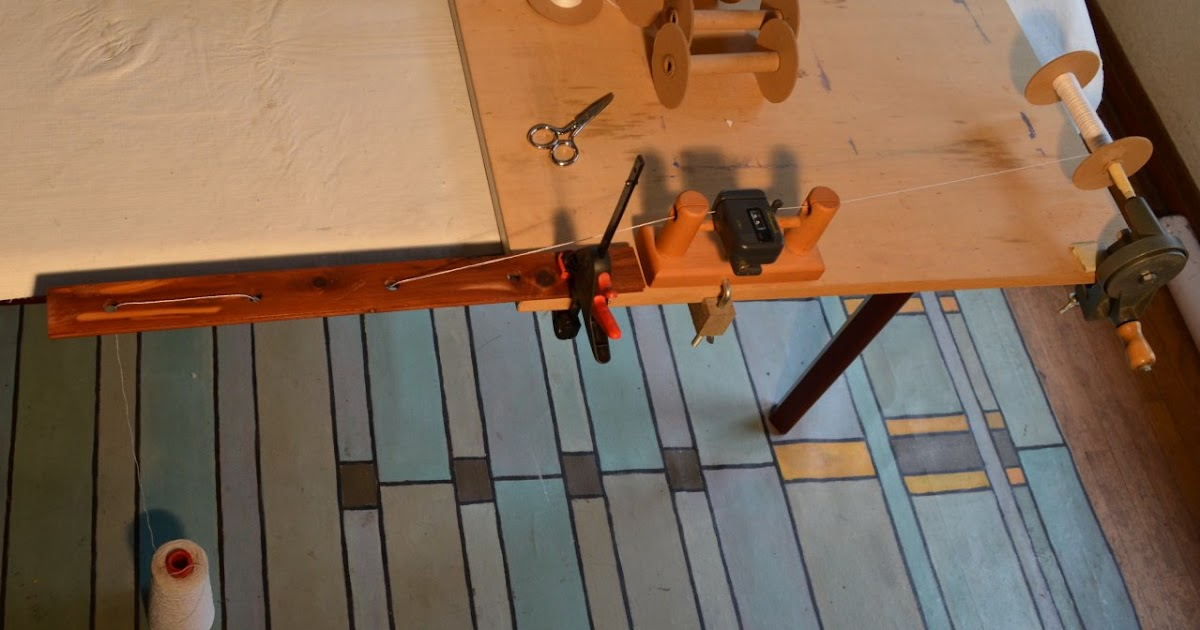 A Fiberartisan S Weaving Path Warping A Sectional Beam 1