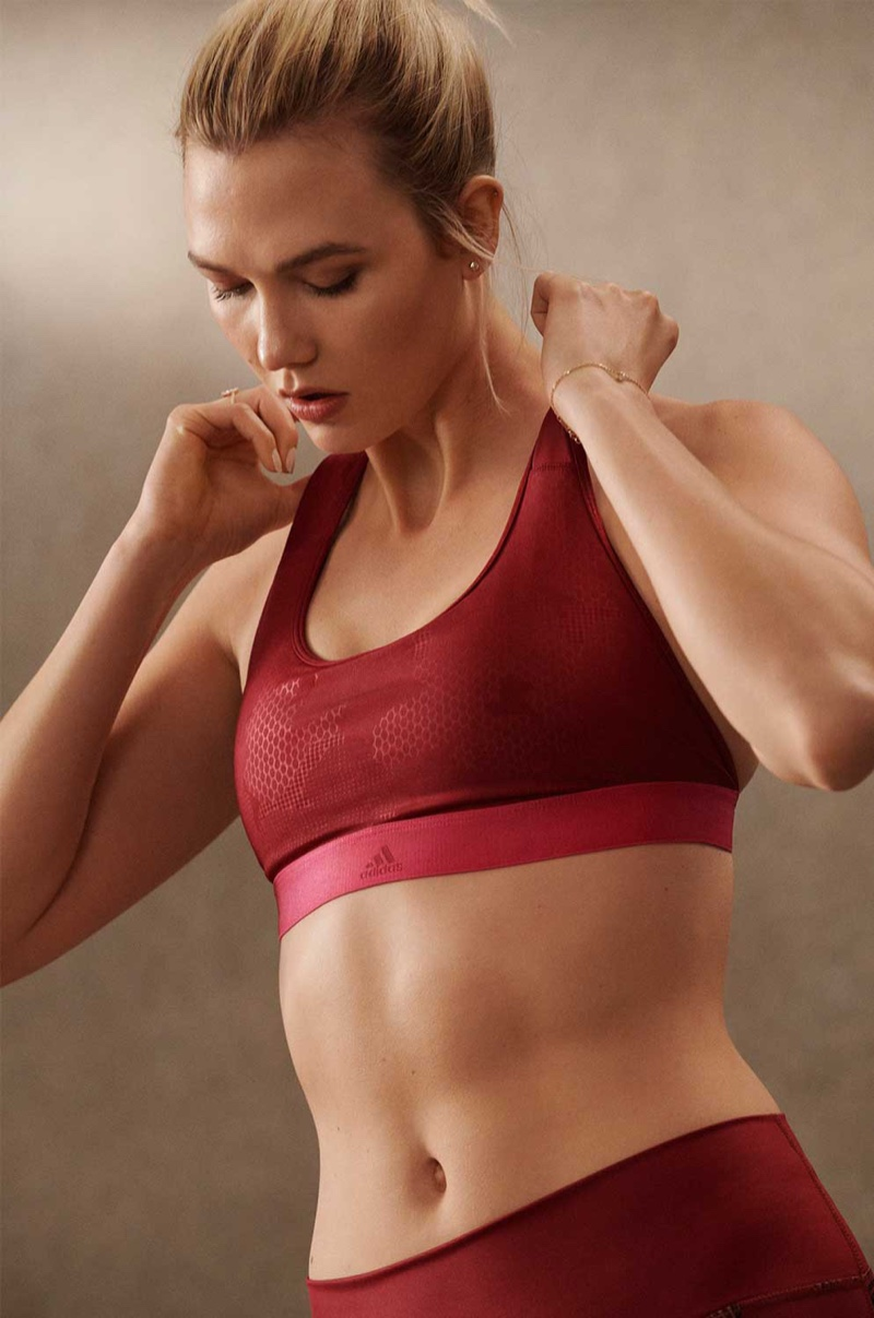 Posing in a gym ready look, Karlie Kloss models adidas styles