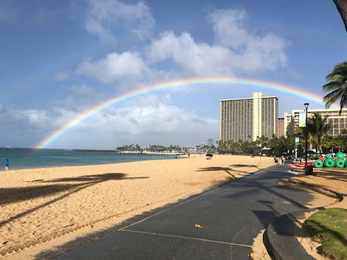 It doesn't rain for long on Waikiki Beach, and its warm anyway, and ends in beautiful rainbow (Source: Palmia Observatory