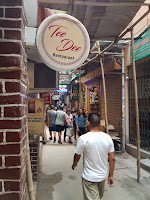 people walking tee dee restaurant sign majnu ka tilla new aruna colony delhi india