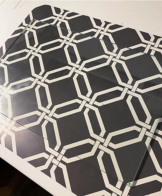 Glass cutting board on a brown mat