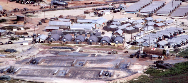 An aerial view of the 22nd Surgical Hospital in Vietnam (far right) where John Fogle was first treated in 1969 after being shot at three times by enemy fire, nearly losing his leg. The pavement area was used as the helo pad. (courtesy of Terry Caskey)