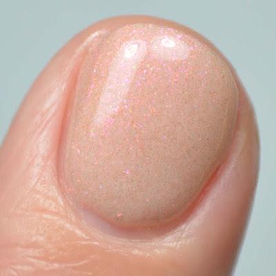 peach shimmer nail polish close up swatch