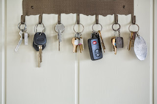 Keys hanging on hooks on wall