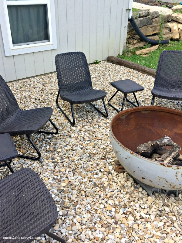 Upgrade your outdoor space by adding cozy lounge furniture to the backyard fire pit area