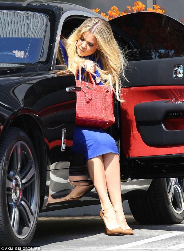 Khloe Kardashian steps out Rolls Royce in skin tight blue dress