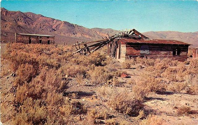 Two old structures and a fallen windmill from an old postcard taken in Garlock.