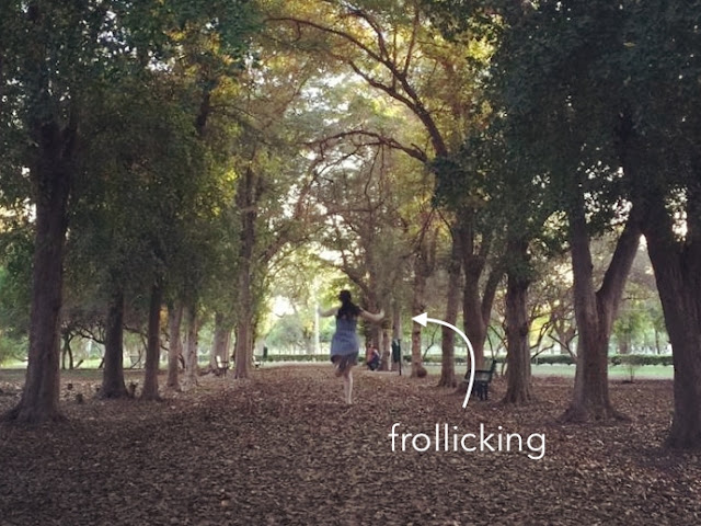 girl frolicking in park
