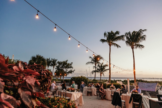 Tropical reception decorations with beach view.