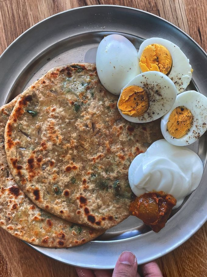two Gobi Paratha served with boiled eggs