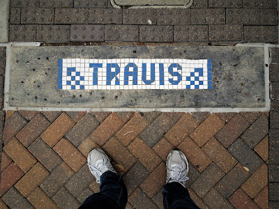 TRAVIS STREET PAVEMENT MARKER in small blue and white tiles