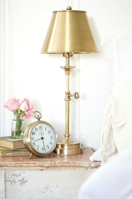 Brass table lamp on nightstand