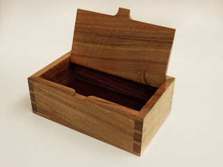 Image of a jewellery box with lid open made of french walnut
