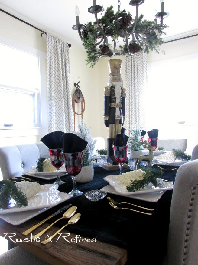 Modern Christmas Table Setting Idea with black, gold, white and red color scheme. #Christmas, #Holiday, #Entertaining, #Modern, #Tablescape
