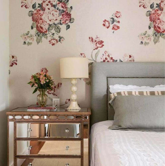 Women's room decoration with floral print wallpaper and mirrored furniture