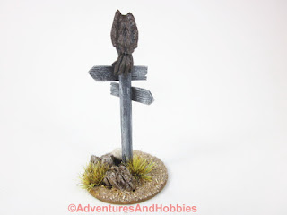 Vulture sitting atop sign post for 25-28mm scale miniature wargaming UniversalTerrain.com - rear view