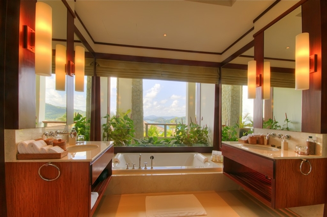 Another bath room with bath tub by the window