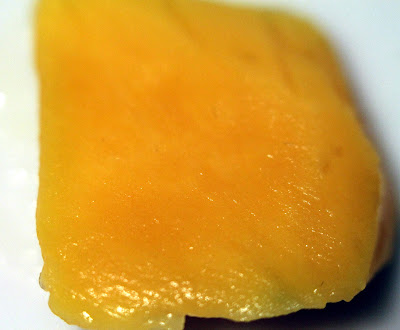 A slice of fresh mango.
