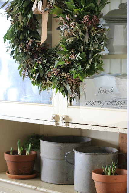 olive wreath and buckets on farmhouse cupboard