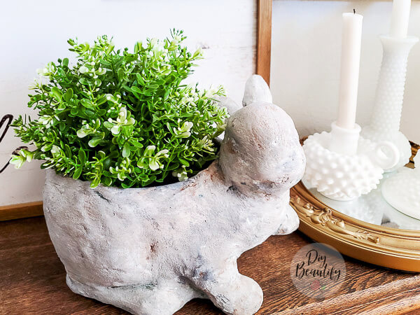 faux stone planter with greenery