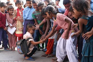 Indian boy worshipping hindu