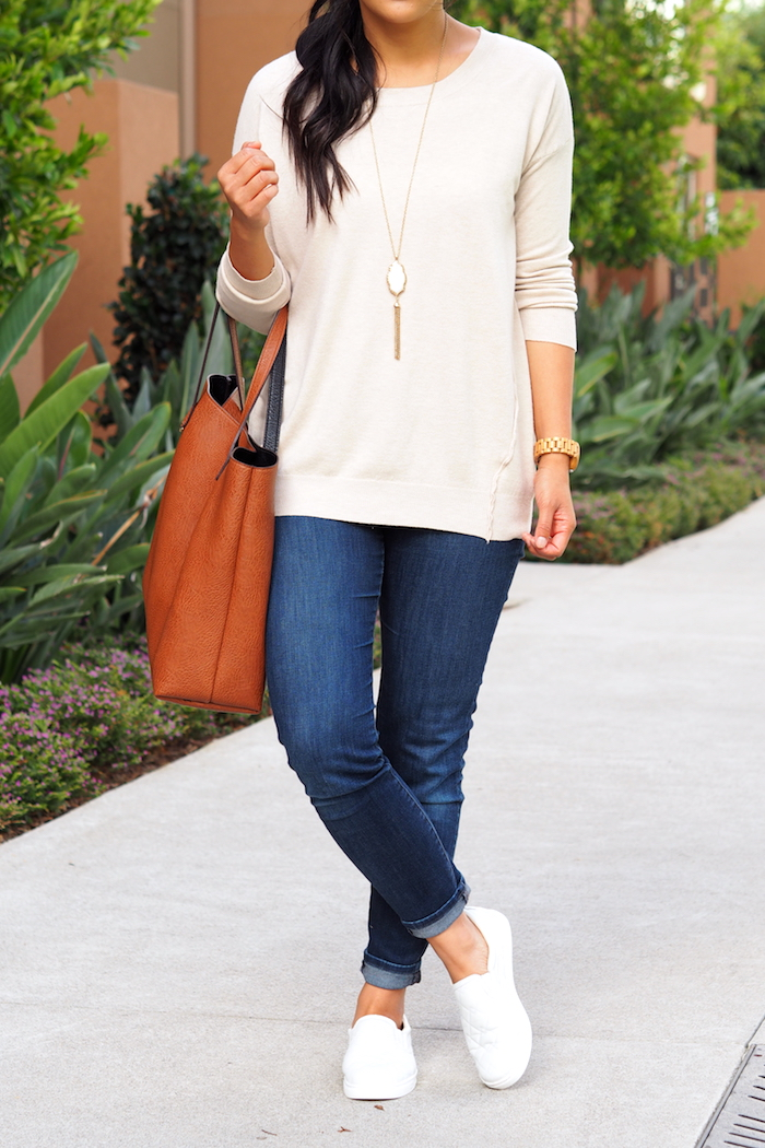 cream sweater + jeans + white slip on sneakers
