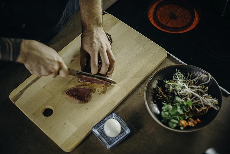 Sharp knife cutting steak