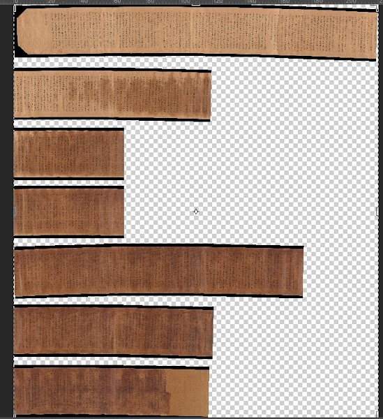 Seven scrolls of yellowed paper of various lengths atop a grey and white checkerboard background.