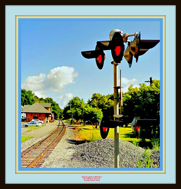 single railroad track passing signals, then station in background