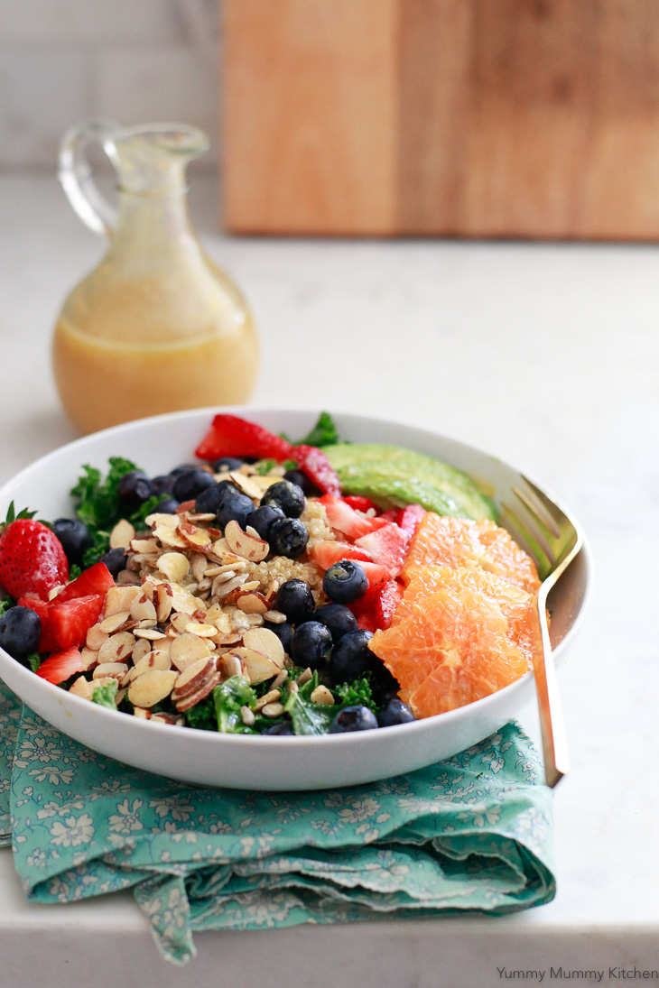 Sweet and tangy fresh orange vinaigrette is used for this superfood salad with kale, quinoa, berries, and oranges. This makes a great vegan and vegetarian lunch idea.