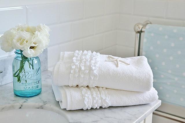 Elegant Bathroom Towels with Flower Arrangement in Vase