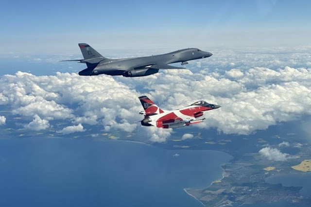 USAF B-1B Lancer trains with colourful Danish F-16 under Bomber Task Force Europe operation