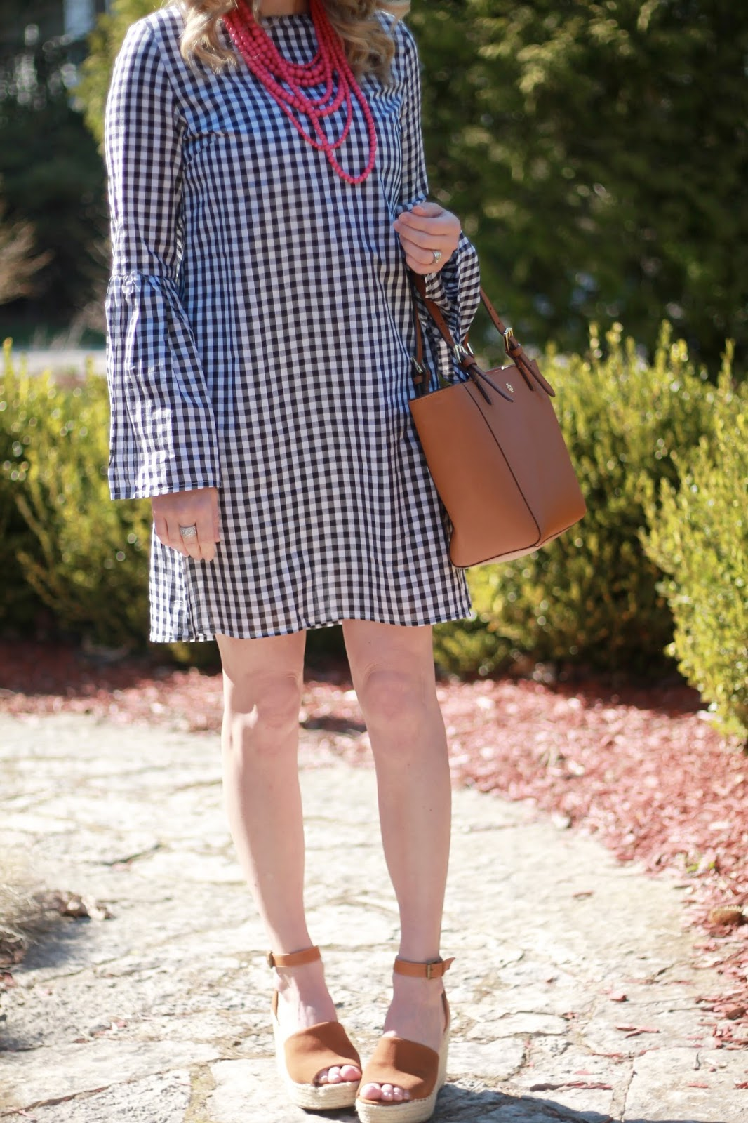 bell sleeved gingham dress, pink beaded necklace, Steve Madden cognac wedges, Tory Burch tote