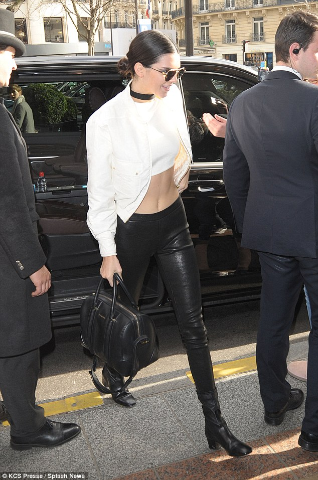 Kendall Jenner shows off abs in cropped top and leather leggings in Paris