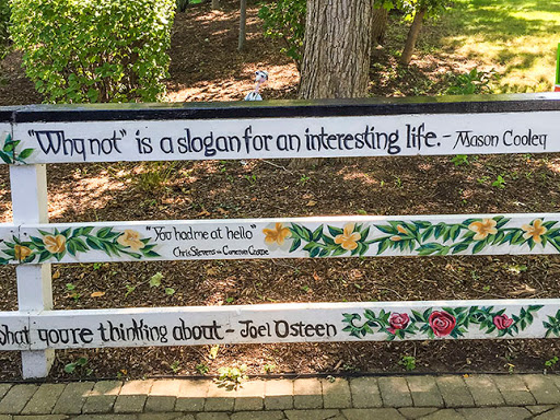 Fence hand painted with slogans and quotes